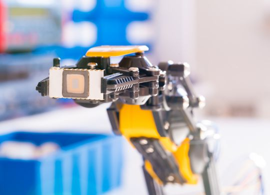 IC electronics chip in robot arm