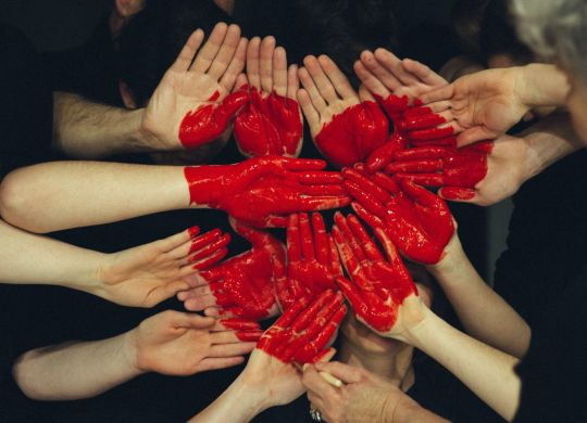 Hands with painted red heart