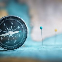 Image of compass and pushpins