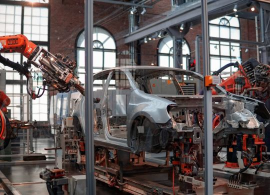 Car being built by robots